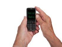 Mains de femme supérieure avec un téléphone portable Photo stock
