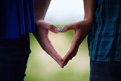 Mains de forme de coeur Image libre de droits