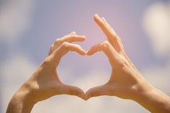 Mains de forme de coeur Image stock