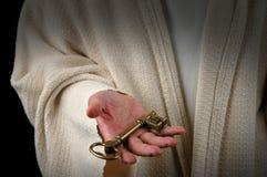 Mains de Jésus et de clé Image stock
