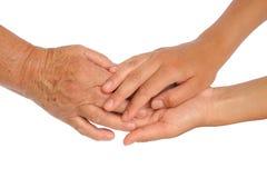 Mains de jeunes et aînées femmes Photos libres de droits