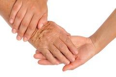 Mains de jeunes et aînées femmes Image libre de droits