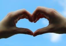 Mains de l'amour Images stock