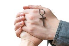Mains de la femme de bénédiction de prêtre d'isolement sur le fond blanc photos stock