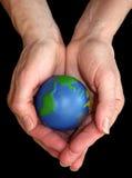 mains de la terre image stock