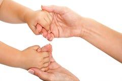 Mains de mère et de chéris ensemble. Photos libres de droits