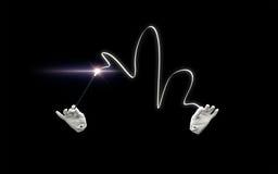 Mains de magicien avec le tour magique d'apparence de baguette magique Photographie stock libre de droits