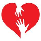 Mains de parent et de chéri sur le coeur Photo libre de droits