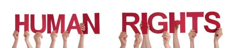 Mains de personnes tenant des droits de l'homme rouges de Word Photographie stock libre de droits