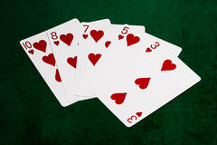 Mains de poker - affleurantes - coeurs Photographie stock