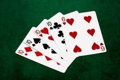 Mains de poker - quatre d'une sorte - dix et six Image stock