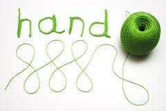 Mains de tricotage Photos stock