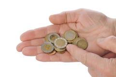 Mains de vieil homme comptant l'argent Photographie stock
