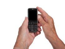 Mains de womanwith supérieur un téléphone portable Images stock