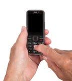 Mains de womanwith supérieur un téléphone portable Photographie stock libre de droits