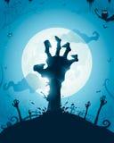 Mains de zombi sur la pleine lune Image stock