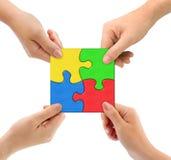 Mains et équipe de puzzle Image stock