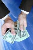 Mains et argent Images stock