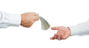 Mains et argent Photos libres de droits