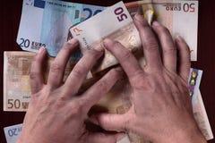 Mains et argent sales Photographie stock
