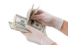 Mains et dollars enfilés de gants Photo libre de droits