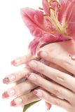 Mains et fleur de femme Photographie stock