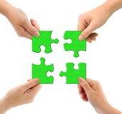 Mains et puzzle Photo libre de droits
