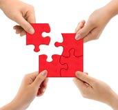 Mains et puzzle Photo stock