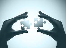 Mains et puzzle Images stock