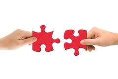 Mains et puzzle Images libres de droits