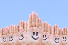 Mains et sourire Image stock