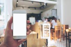 Mains et téléphone intelligent Image stock