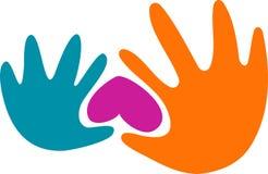 Mains et un coeur Photo stock