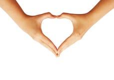 Mains faisant le symbole de coeur d'amour Image stock
