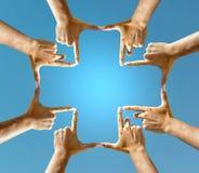 Mains faisant une croix Photo libre de droits