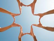 Mains faisant une croix Photos libres de droits