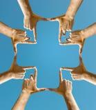 Mains faisant une croix Photographie stock