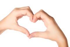 Mains formant la forme de coeur d'isolement sur le blanc Photos libres de droits