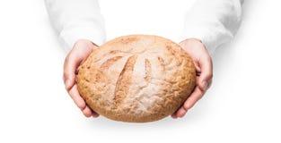 Mains humaines avec du pain Photo stock