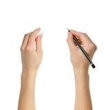 Mains humaines avec le caoutchouc de crayon et de gomme à effacer Photo stock