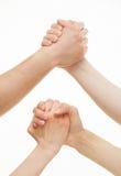 Mains humaines démontrant un geste des différends ou d'une solidarité Photos stock