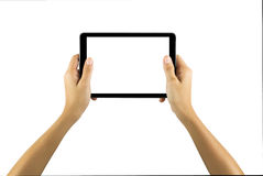 Mains jugeant la tablette blanche d'isolement sur le fond blanc Photo libre de droits