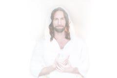 Mains levées par Pâques sur le blanc de coeur Images libres de droits