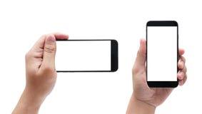 Mains masculines d'isolement jugeant le téléphone semblable à l'iphone dans le diffe photo libre de droits