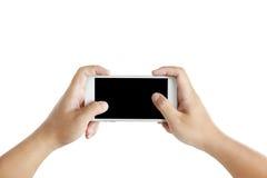 Mains masculines d'isolement tenant le téléphone Photographie stock