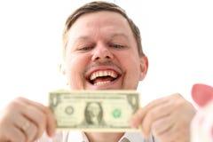 Mains masculines tenant un billet de banque de dollar US faisant une certaine remarque au sujet de réussite commerciale image libre de droits