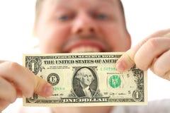 Mains masculines tenant un billet de banque de dollar US faisant une certaine remarque au sujet de r?ussite commerciale photo libre de droits