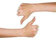Mains montrant des pouces en haut et en bas (d'isolement sur le backgr blanc Photographie stock libre de droits