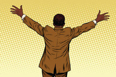 Mains ouvertes d'homme d'affaires arrière d'Afro-américain pour des étreintes Photographie stock