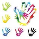 Mains peintes colorées Photo stock